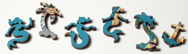 An image showing six whimsy pieces from a wooden jigsaw puzzle. They're basically puzzle pieces that are shaped like something recognizable instead of a normal puzzle piece. These ones are shaped like mermaids, palm trees, and an anchor.